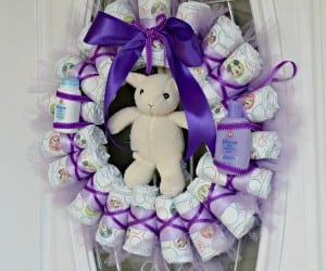 This Diaper Wreath is a perfect option for your next baby shower. It is easy to make and so adorable!