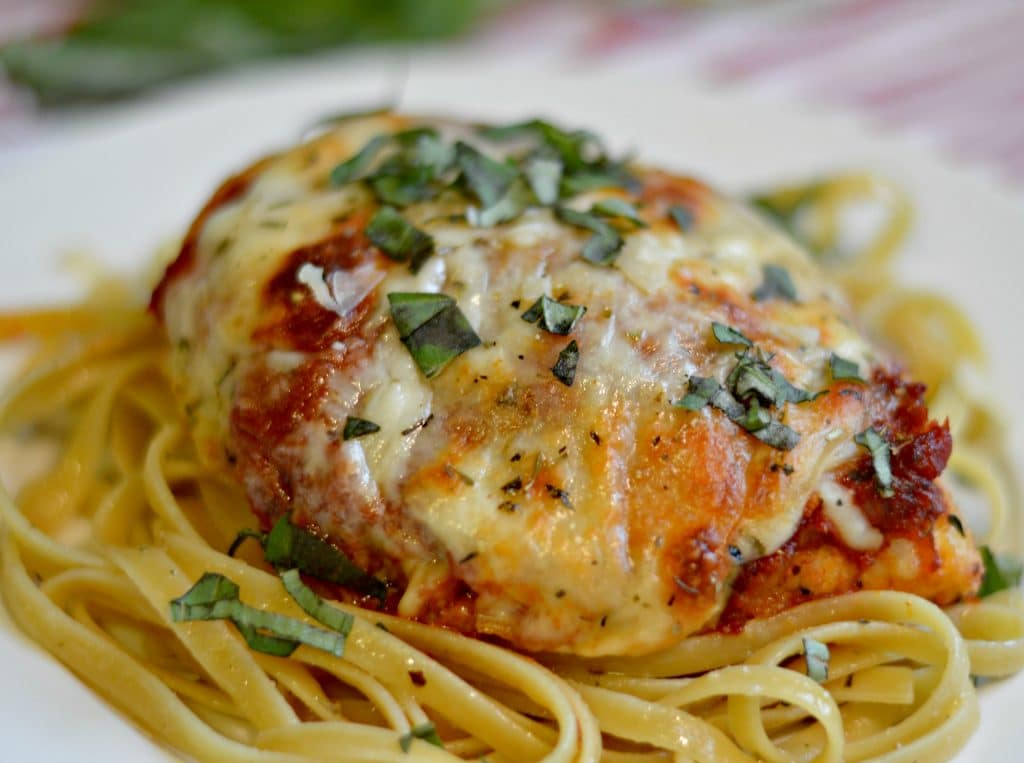 This three cheese Chicken Parmesan is sure to be a hit with everyone that tries it. It has three different types of cheeses with delicious pasta sauce makes for an amazing meal to enjoy with your family any night of the week!