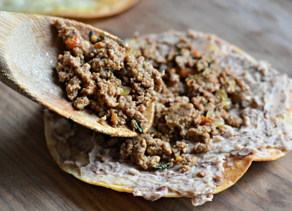 This delicious recipe for traditional Mexican tostadas is super easy to make and perfect for your next fiesta!