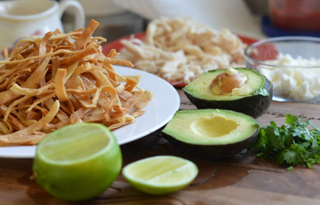 Fried tortilla strips and other garnishes