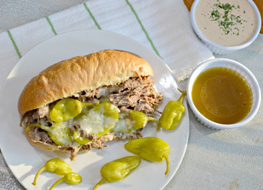 Slow Cooker Italian Beef Sandwich recipe with slow cooked, tender beef, delicious golden Mezzetta peperoncini, and soft bread.