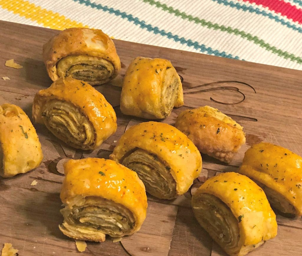 Easy Olive Oil and Garlic Puff Pastry Pinwheels are full of flavor and a perfect side dish for your barbecues this year.