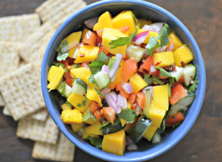 This fresh and easy mango and cucumber salsa, with fresh mango, cucumber, and more, will hit all the spots this summer.