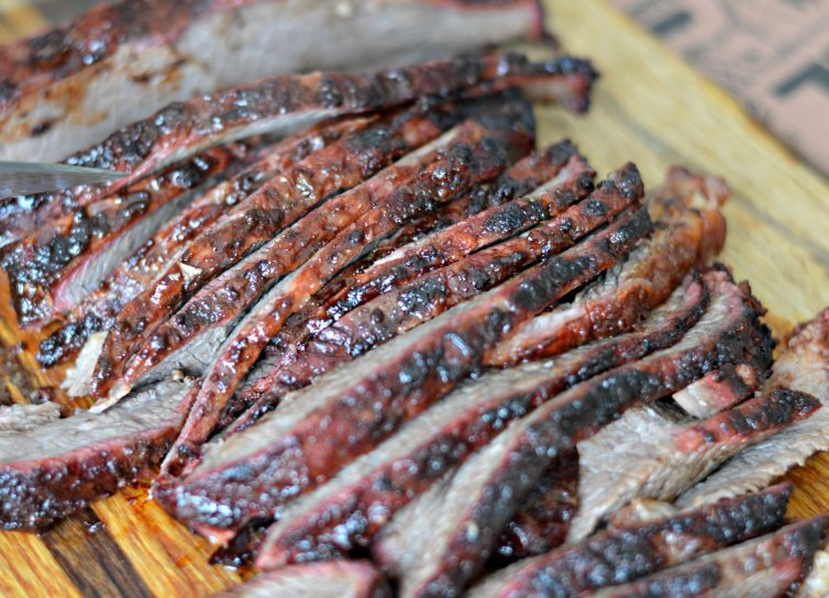 This Smoked Brisket Recipe will have everyone licking their fingers and asking for more. The secret is in the delicious, homemade mop sauce and the slow cook on the Traeger wood pellet grill.