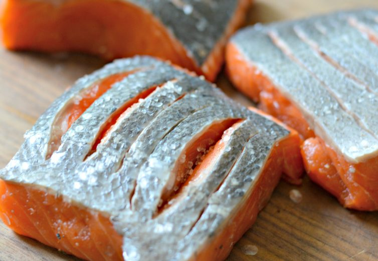 Keep reading to find out how to make a tasty crispy skin salmon with lemon garlic sauce using delicious Alaska king salmon.