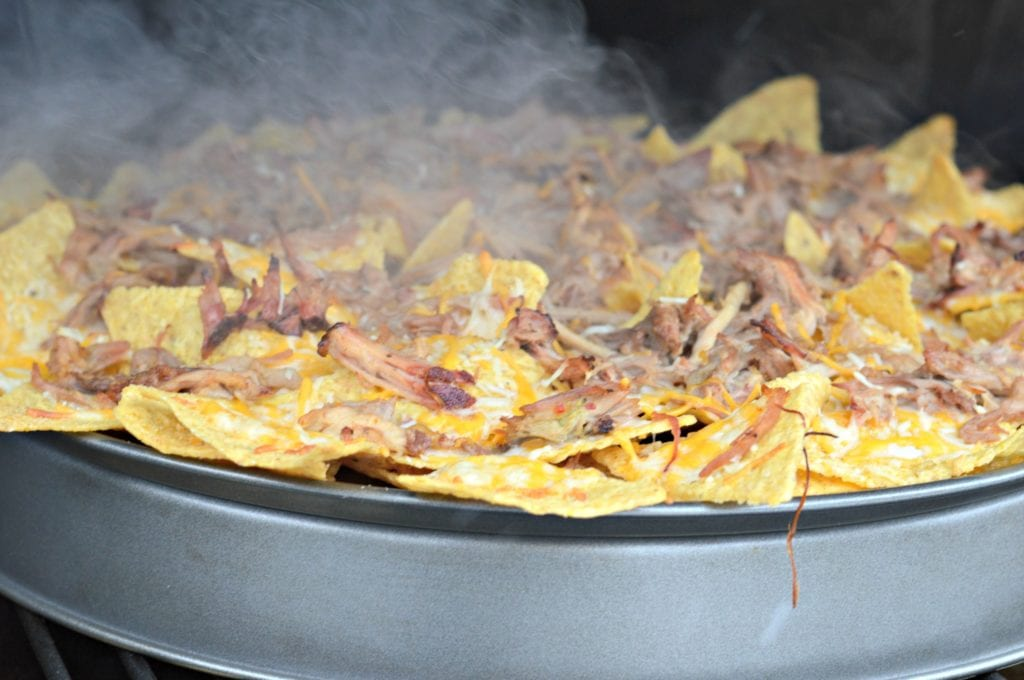 Wood Pellet Smoked Nachos with smoke rising
