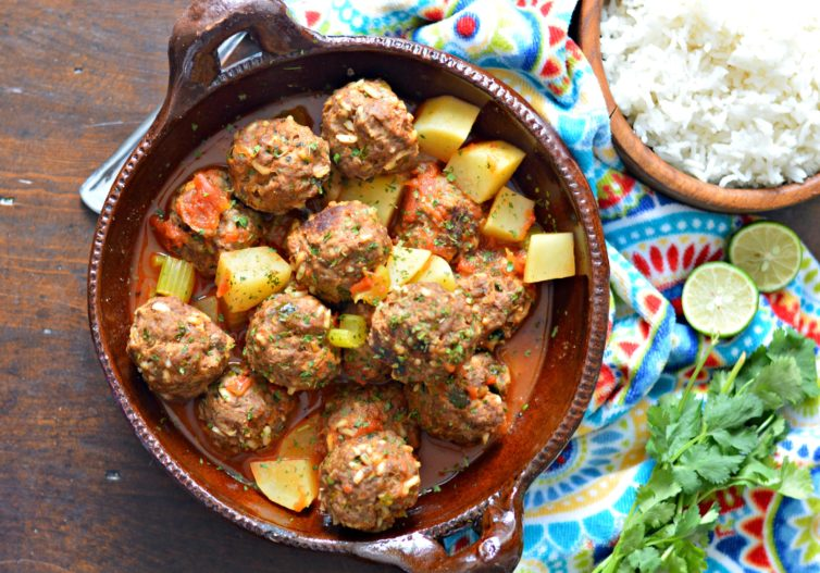 Mexican meatball soup (albondigas) with garnishes