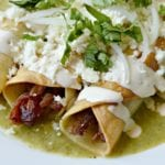 taquitos smoked pulled pork and salsa verde close up