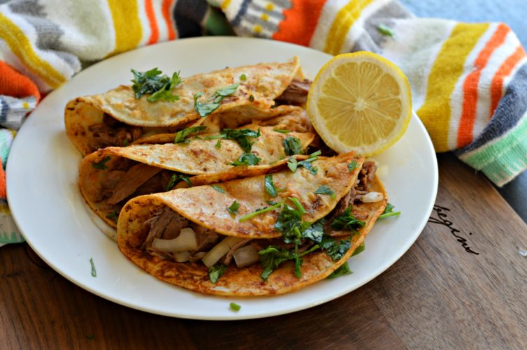Birria Tacos with lemon