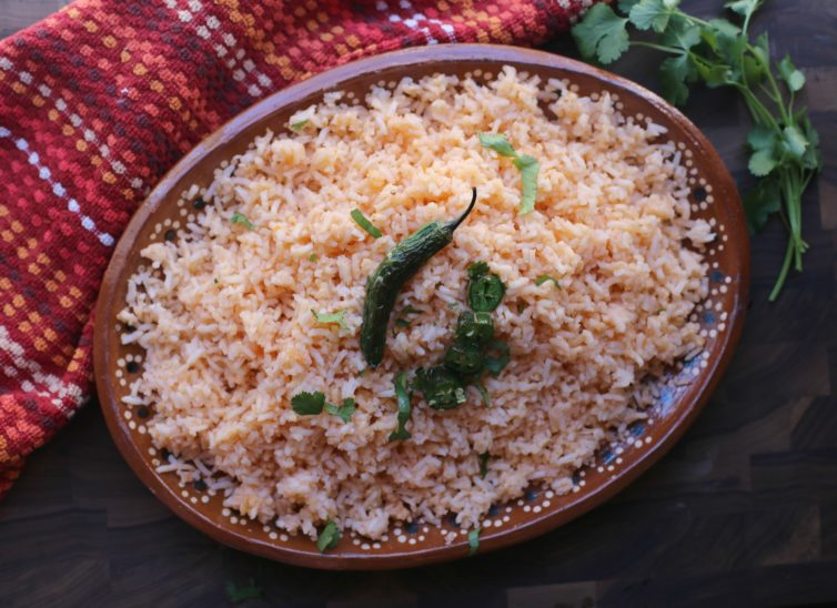 mexican rice in a brown bowl