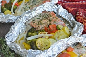 Grilled Salmon in foil with veggies and herbs