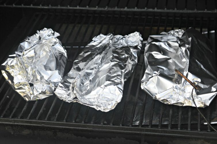 Salmon in foil on grill cooking