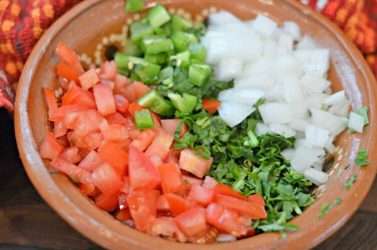 tomato, onion, jalapenos, cebolla and cilantro in a bowl