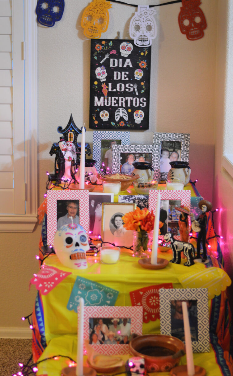 day of the dead altar with pictures and food