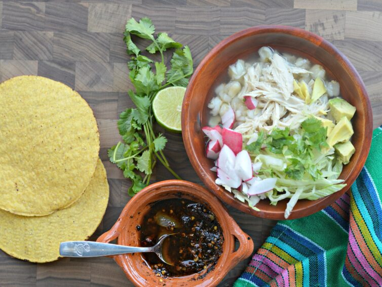 Pozole blanco on a table ready to eat