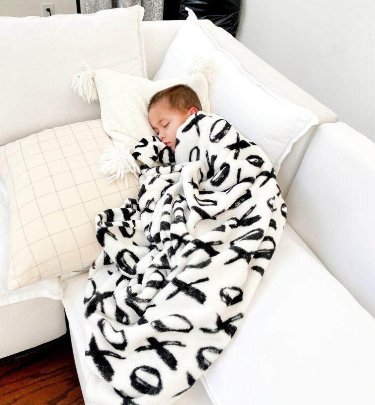 little boy sleeping on couch from the Futon Shop