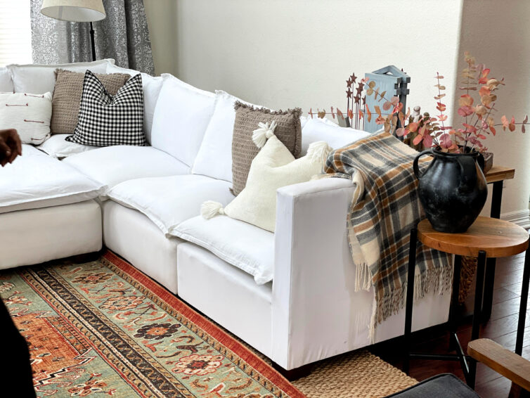 white furniture in the great room with rug
